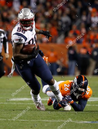 New England Patriots tight end Martellus Bennett runs against the Denver Broncos during the first half of an NFL football game, in Denver