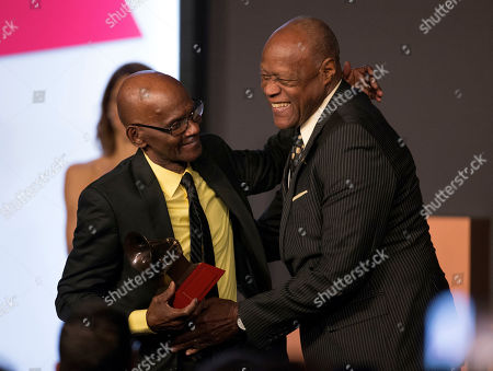 Cuco Valoy, Johnny Ventura. Cuco Valoy, left, is presented with the lifetime achievement award by Johnny Ventura at the Latin Grammy special merit awards at the Four Seasons Hotel, in Las Vegas