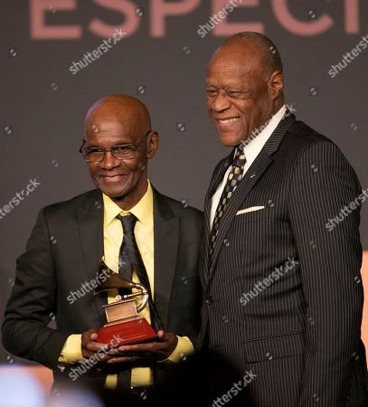 Stock Photo of Cuco Valoy, Johnny Ventura. Cuco Valoy, left, is presented with the lifetime achievement award by Johnny Ventura at the atin Grammy special merit awards at the Four Seasons Hotel, in Las Vegas