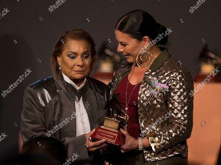 Olga Tanon, Lucecita Benitez. Lucecita Benitez, left, receives the lifetime achievement award from Olga Tanon during the Latin Grammy special merit awards at the Four Seasons Hotel, in Las Vegas