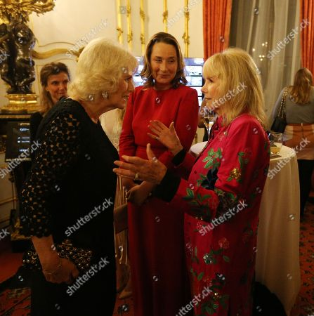 Camilla Duchess of Cornwall speaks to actress Susan Hampshire (right) as she attends the Bruce Oldfield Fashion Show at Lancaster House in London, in support of the National Osteoporosis Society.