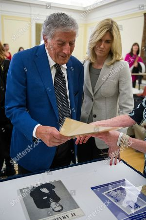 Singer Tony Bennett and his wife Susan Benedetto look at memorabilia from his early career as they tour the Library in Washington, . Bennett is being honored as the recipient of the Library of Congress Gershwin Prize for Popular Song