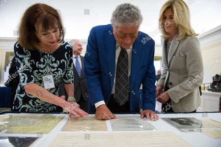 Jan Lauridsen with the Library of Congress music division, left, shows singer Tony Bennett and his wife Susan Benedetto memorabilia from his early career as they tour the Library in Washington, . Bennett is being honored as the recipient of the Library of Congress Gershwin Prize for Popular Song