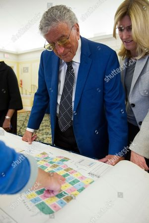 Singer Tony Bennett and his wife Susan Benedetto look at a map of the New York Astoria/Queens neighborhood where he was born as they tour the Library in Washington, . Bennett is being honored as the recipient of the Library of Congress Gershwin Prize for Popular Song