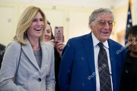 Singer Tony Bennett and his wife Susan Benedetto watch a video of Bennett performing on the television show The Simpsons in 1990, while they tor the Library of Congress where he is being honored as the recipient of the Library of Congress Gershwin Prize for Popular Song, in Washington