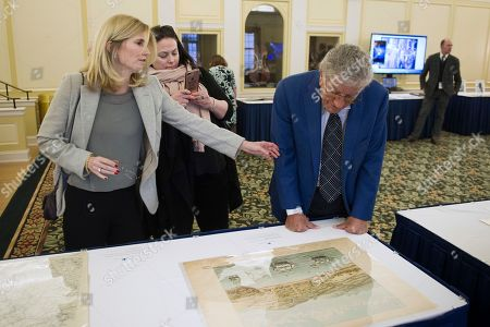 Singer Tony Bennett, his wife Susan Benedetto, left, and daughter Johanna Bennett, center, look at a map of 1847 San Francisco, as they tour the Library in Washington, . Bennett is being honored as the recipient of the Library of Congress Gershwin Prize for Popular Song