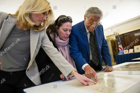 Singer Tony Bennett, his wife Susan Benedetto, left, and daughter Johanna Bennett, center, look at a map of Calabria, Itay, where his father was born, as they tour the Library in Washington, . Bennett is being honored as the recipient of the Library of Congress Gershwin Prize for Popular Song