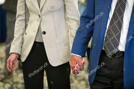 Stock Picture of Singer Tony Bennett holds hands with his wife Susan Benedetto as they tour the Library of Congress where he is being honored as the recipient of the Library of Congress Gershwin Prize for Popular Song, in Washington