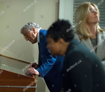 Singer Tony Bennett, left, his wife Susan Benedetto, right, and the Librarian of Congress' Carla Hayden, center, tour the Library's George Gershwin exhibit in Washington, . Bennett is being honored as the Library of Congress Gershwin Prize for Popular Song