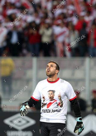 Peru's goalkeeper Jose Carvallo, wearing a T-shirt with a picture of the suspended forward Paolo Guerrero, trains prior to the FIFA World Cup 2018 qualification playoff second leg match between Peru and New Zealand, at the National Stadium of Lima, Peru, 15 November 2017.