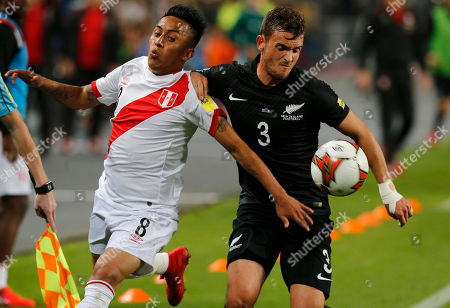 Peru's Christian Cueva, left, fights for the ball with Peru's Aldo Corzo during a play-off qualifying match for the 2018 Russian World Cup in Lima, Peru