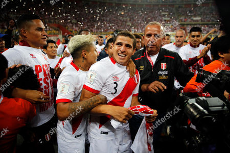 Peru's Aldo Corzo, center, celebrates with teammates after a play-off qualifying match for the 2018 Russian World Cup against New Zealand in Lima, Peru, . Peru beat New Zealand 2-0 to win a two-leg playoff and earn the 32nd and last spot in the World Cup field in Russia