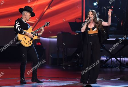 "Stock Image of Jesse Huerta, Joy Huerta. Jesse Huerta, left, and Joy Huerta, of Jesse Y Joy, perform ""Siempre Es De Noche"" at the Latin Recording Academy Person of the Year tribute honoring Alejandro Sanz at the Mandalay Bay Convention Center, in Las Vegas"