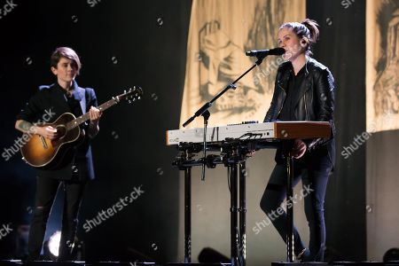 Stock Image of Tegan Quin and Sara Quin of indie pop band Tegan and Sara perform on The Con X: Tour at the Paramount Theater