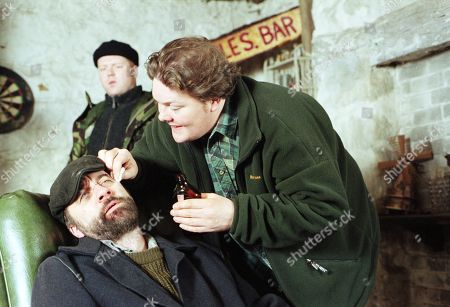 Ep 2321 Tuesday 10th February 1998 Knocked unconscious by Lord Alex's men during a diamond heist, Zak's cut head is treated by Paddy - With Paddy Kirk, as played by Dominic Brunt ; Zak Dingle, as played by Steve Halliwell ; Butch Dingle, as played by Paul Loughran.