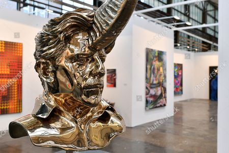 A view of the bronze statue 'Chapitre VI, Water Buffalo' (R) by Belgian artist Jan Fabre on display in the international art fair ART DUESSELDORF at Areal Boehler, in Duesseldorf, Germany, 16 November 2017. Around 80 established and young galleries from 21 countries will present modern and contemporary art from between 1945 and 2017 in the halls of the former factory complex Areal Boehler. The fair's first edition will be held from 17 to 19 November 2017.