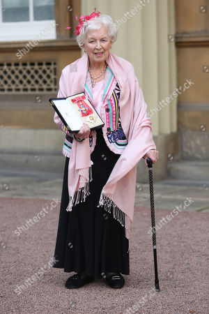 Dame June Whitfield shows her award after she was made a Dame Commander of the Most Excellent Order of the British Empire for services to Drama and Entertainment