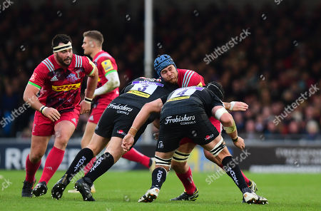 James Horwill captain of of Harlequins goes into contact with Moray Low of Exeter Chiefs and Mitch Lees of Exeter Chiefs