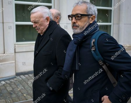 Jose Maria Marin, left, arrives at federal court in the Brooklyn borough of New York, . Marin is one of three former South American soccer officials who are going on trial in a U.S. case highlighting widespread corruption in the sport's governing body