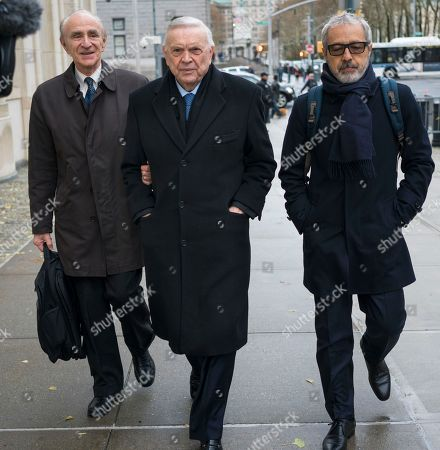 Jose Maria Marin, center, arrives at federal court in the Brooklyn borough of New York, . Marin is one of three former South American soccer officials who are going on trial in a U.S. case highlighting widespread corruption in the sport's governing body