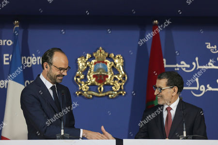 France's Prime Minister Edouard Philippe speaks, left, shakes hands with his Moroccan counterpart Saad-Eddine El Othmani, right, after a press conference in Rabat, Morocco, . Philippe is in Morocco to try to reinvigorate trade with the North African kingdom, as the former French protectorate increasingly positions itself as an economic pillar of Africa