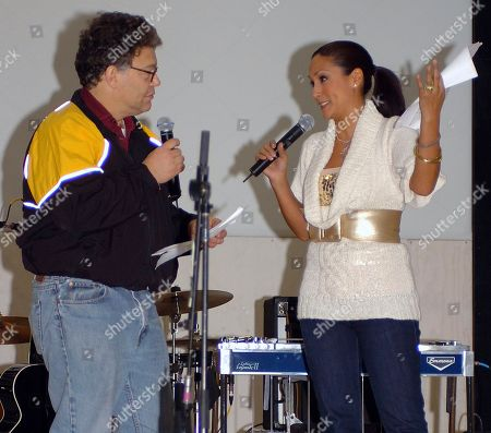In this image provided by the U.S. Army, then-comedian Al Franken and sports commentator Leeann Tweeden perform a comic skit at Forward Operating Base Marez in Mosul, Iraq,, during the USO Sergeant Major of the Army's 2006 Hope and Freedom Tour. Sen. Al Franken, D-Minn., apologized Nov. 16, 2017, after Tweeden accused him of forcibly kissing her during the 2006 USO tour. Colleagues, including fellow Democrats, urged a Senate ethics investigation. Tweeden also accused Franken of posing for a photo with his hands on her breasts as she slept, while both were performing for military personnel two years before the one-time comedian was elected to the Senate
