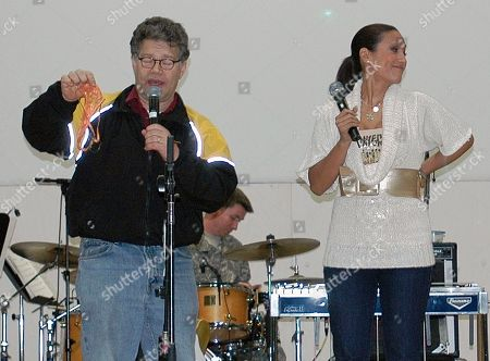 In this image provided by the U..S,. Army, then-comedian Al Franken and sports commentator Leeann Tweeden perform a comic skit at Forward Operating Base Marez in Mosul, Iraq,, during the USO Sergeant Major of the Army's 2006 Hope and Freedom Tour. Sen. Al Franken, D-Minn., apologized Nov. 16, 2017, after Tweeden accused him of forcibly kissing her during the 2006 USO tour. Colleagues, including fellow Democrats, urged a Senate ethics investigation. Tweeden also accused Franken of posing for a photo with his hands on her breasts as she slept, while both were performing for military personnel two years before the one-time comedian was elected to the Senate