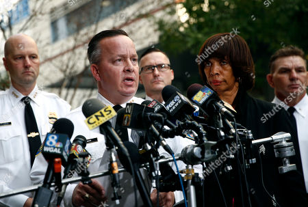 Kevin Davis, Catherine Pugh. Baltimore Police Department Commissioner Kevin Davis, left, speaks alongside Mayor Catherine Pugh at a news conference outside the R Adams Cowley Shock Trauma Center in Baltimore, to announce the death of Det. Sean Suiter. Suiter was shot in the head Wednesday while working in a troubled area of the city grappling with high crime rates