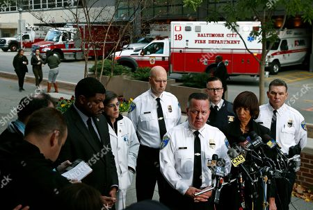 Kevin Davis, Catherine Pugh. Baltimore Police Department Commissioner Kevin Davis, third from right, speaks alongside Mayor Catherine Pugh at a news conference outside the R Adams Cowley Shock Trauma Center in Baltimore, to announce the death of Det. Sean Suiter. Suiter was shot in the head Wednesday while working in a troubled area of the city grappling with high crime rates