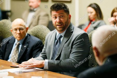 Andrew McDonald speaks during a meeting of the Legislative Compensation Board in Oklahoma City, . All of Oklahoma's 149 state senators and representatives will get a pay cut of 8.8 in November 2018 after the board narrowly voted to approve the reduction