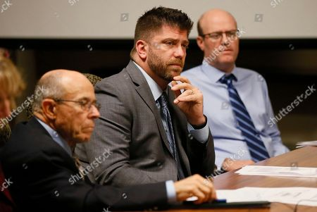 Stock Picture of Mike O'Neal, Andrew McDonald, Keith Cochran. From left, Mike O'Neal, Andrew McDonald and Keith Cochran listen during a meeting of the Legislative Compensation Board in Oklahoma City, . All of Oklahoma's 149 state senators and representatives will get a pay cut of 8.8 in November 2018 after the board narrowly voted to approve the reduction