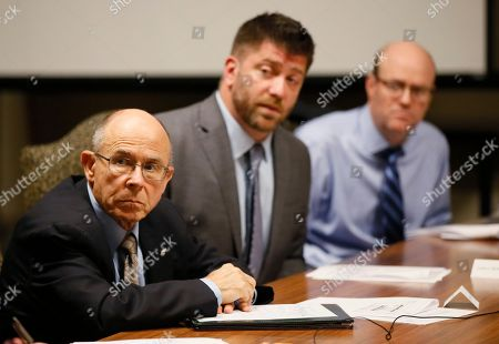 Stock Photo of Mike O'Neal, Andrew McDonald, Keith Cochran. From left, Mike O'Neal, Andrew McDonald and Keith Cochran listen during a meeting of the Legislative Compensation Board in Oklahoma City, . All of Oklahoma's 149 state senators and representatives will get a pay cut of 8.8 in November 2018 after the board narrowly voted to approve the reduction