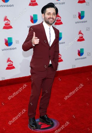 Eduardo Cabra arrives at the 18th annual Latin Grammy Awards at the MGM Grand Garden Arena, in Las Vegas