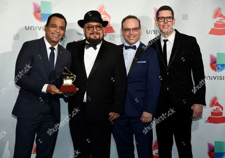 """Jon Secada, left, and The Charlie Sepulveda Big Band pose in the press room with the award for best traditional tropical album for """"To Beny More With Love"""" at the 18th annual Latin Grammy Awards at the MGM Grand Garden Arena, in Las Vegas"""