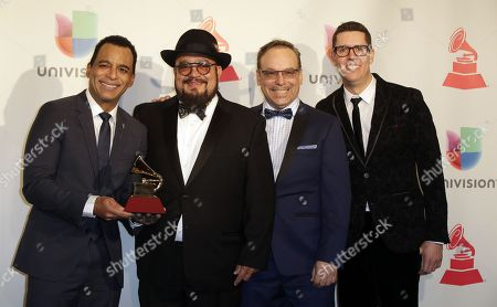 Jon Secada (L)  Featuring The Charlie Sepulveda Big Band members pose with their award for ?Best Traditional Tropical Album' in the press room during the 18th Annual Latin Grammy Awards at the MGM Grand Garden Arena in Las Vegas, Nevada, USA, 16 November 2017. Latin Grammy Awards recognize artistic and/or technical achievement, not sales figures or chart positions, and the winners are determined by the votes of their peers-the qualified voting members of the academy.