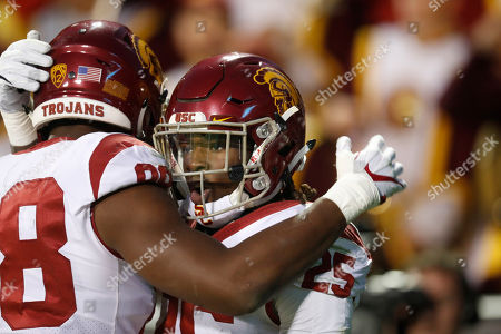 Daniel imatorbhebhe, roandl jones 2. USC Trojans tight end Daniel Imatorbhebhe (88) congratulates running back Ronald Jones II (25) after his touchdown run against the Colorado Buffaloes in the second half of an NCAA college football game, in Boulder, Colo. USC won 38-24