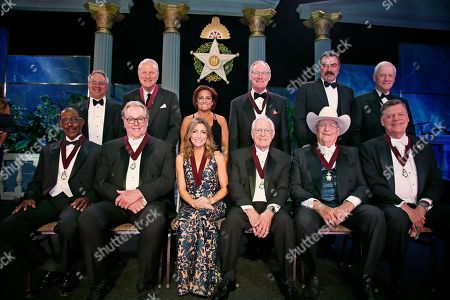 Stock Photo of Tom Colbert, Kenneth Levit, Hal Smith, Barry Switzer, Shannon Miller, Mary Lou Retton, Phil Parduhn, Burns Hargis, Bob Funk, Tom Selleck, Tom Cole, Frank Keating. Oklahoma Hall of Fame Inductees are pictured with their presenters in Oklahoma City, . From left, front row, Justice Tom Colbert, with presenter Kenneth Levit back row, Hal Smith, with presenter Barry Switzer, back row, Shannon Miller, with presenter Mary Lou Retton, back row, Phil Parduhn, with presenter Burn Hargis, back row, Bob Funk, with presenter Tom Select, back row and Congressman Tom Cole, with presenter Frank Keating, back row