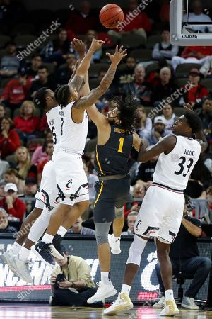 Chad Andrews-Fulton, Trevor Moore, Justin Jenifer, Nysier Brooks. Coppin State's Chad Andrews-Fulton (1) vies for a rebound against Cincinnati's Trevor Moore (5), Justin Jenifer (3), and Nysier Brooks (33) during the second half of an NCAA college basketball game, in Cincinnati