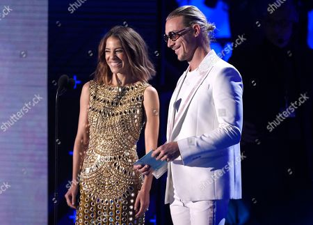 Diplo, Debi Nova. Diplo, right, and Debi Nova present the award for record of the year at the 18th annual Latin Grammy Awards at the MGM Grand Garden Arena, in Las Vegas