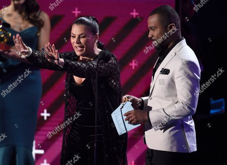 Olga Tanon, Alexandre Pires. Olga Tanon, left, and Alexandre Pires present the award for album of the year at the 18th annual Latin Grammy Awards at the MGM Grand Garden Arena, in Las Vegas
