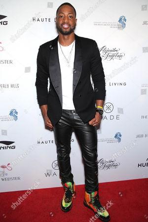 Dwyane Wade arrives during the Li-Ning & Alejandro Ingelmo shoe design unveiling at the Ritz-Carlton Residences, Miami Beach on in Miami Beach, FL