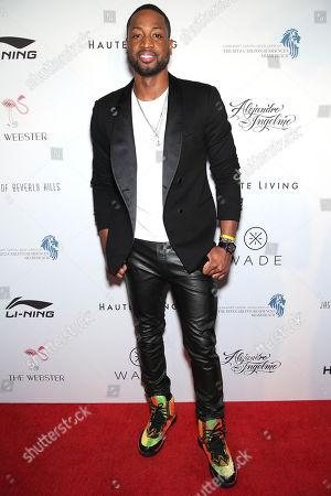 Dwyane Wade arrives during the Li-Ning & Alejandro Ingelmo shoe design unveiling at the Ritz-Carlton Residences, Miami Beach on in Miami Beach, Fla