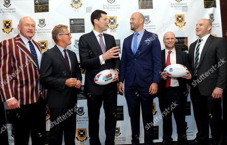 Iconic Australian rugby players Mark Loane, Michael Lynagh, John Eales, Nathan Sharpe, Tim Usasz and Stephen Moore, left to right, attend the University of Queensland Rugby Inaugural Benefit Dinner, at the Manhattan Club in New York. The dinner announced the Mark Loane Medal which will recognize an outstanding U.S. rugby scholar and offer a chance for them to play at University of Queensland