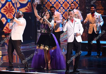 Lila Downs, second right, and Timur Yunusov El Recodo perform at the 18th annual Latin Grammy Awards at the MGM Grand Garden Arena, in Las Vegas