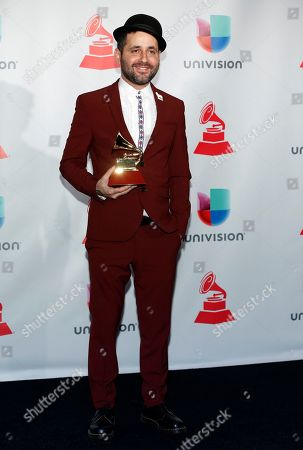 Eduardo Cabra poses in the press room with the award for producer of the year at the 18th annual Latin Grammy Awards at the MGM Grand Garden Arena, in Las Vegas