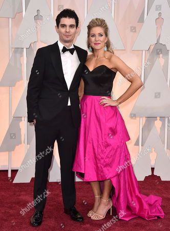 Damien Chazelle, left, and Jasmine McGlade arrive at the Oscars, at the Dolby Theatre in Los Angeles