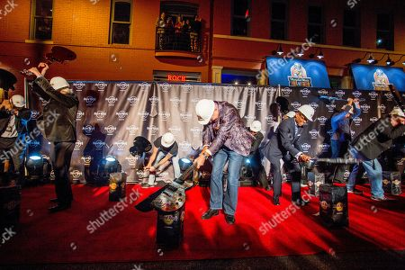 Hamish Dodds, President and CEO of Hard Rock International and Mayor of the City of Memphis, A C Wharton, Jr. smash defective non-playable guitars with 14 others to commemorate the Grand Reopening of Hard Rock Cafe Memphis, on in Memphis, Tenn