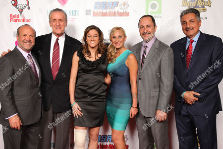 Ron Book, Miami HEAT President and Hall of Fame inductee, Pat Riley, CNN Correspondent & Pulitzer Prize recipient, Sara Ganim, Lauren's Kids founder, Lauren Book, Sun Sports HEAT TV broadcasters, Eric Reid and Tony Fiorentino attend the Seventh Annual Reid & Fiorentino Call of the Game Dinner Presented by Publix at the Seminole Hard Rock Hotel & Casino on Saturday, March 9th, 2013 in Hollywood, Fl. Laurenâ?™s Kids is a Florida-based organization aimed at preventing child sexual abuse and healing survivors through education and awareness. The organization, headquartered in Aventura, Florida, was started by Lauren Book, M.S. Ed., a survivor of childhood sexual abuse who endured abuse at the hands of her nanny for six years