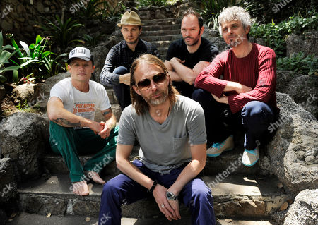 This, photo shows members of the band Atoms For Peace, from left, Flea, Joey Waronker, Thom Yorke, foreground center, Nigel Godrich and Mauro Refosco posing for a portrait in Los Angeles. The band's 27-date tour begins in July in Europe and will reach the US in September before ending in Japan