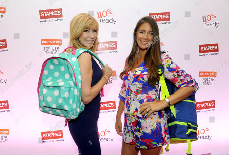 """Stock Photo of TV personality Leeza Gibbons, left, and Jaime Primak Sullivan, star of """"Jersey Belle"""" and """"CawfeeTawk,"""" get ready for back-to-school season with backpacks from Staples during BlogHer15 in New York"""